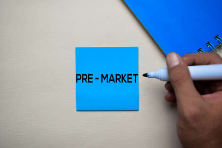 Pre - Market text on sticky notes with office desk. Stock Market Exchange Concept Stok Fotoğraf