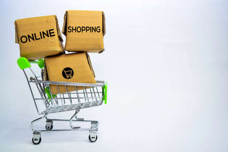 Online Shopping Text in small boxes and shopping cart. Concepts about online shopping. Isolated on white background