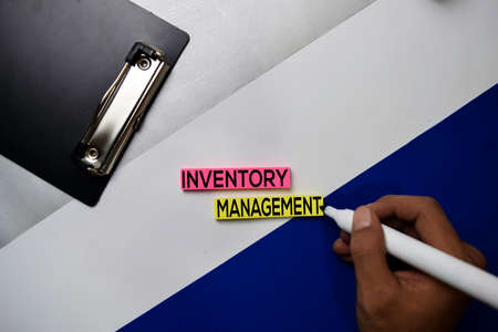 Inventory Management text on sticky notes with color office desk concept