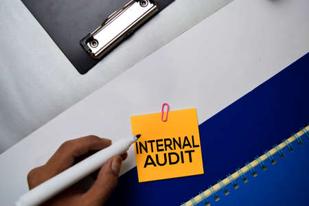 Internal Audit text on sticky notes with color office desk concept