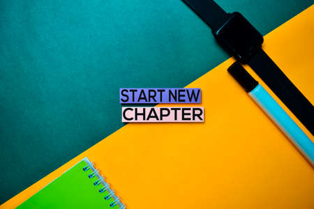 Start New Chapter text on top view color table background.