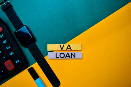 VA Loan text on top view color table background. Stock Photo