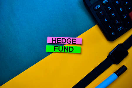 Hedge Fund text on top view color table background. Фото со стока