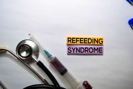 Refeeding Syndrome text on top view isolated on white background. Healthcare/Medical concept Banco de Imagens