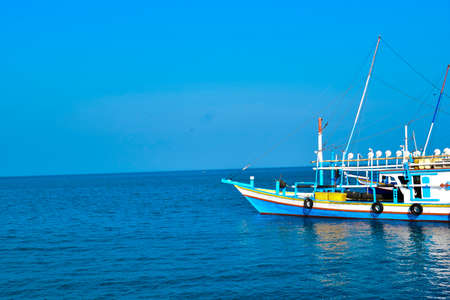 Traditional sailing wooden boat on the water parking at the harbour in summer holiday in Lampung, Indonesia