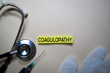 Coagulopathy text on Sticky Notes. Top view isolated on office desk. HealthcareMedical concept