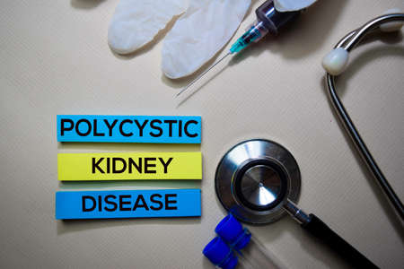 Polycystic Kidney Disease text on Sticky Notes. Top view isolated on office desk. HealthcareMedical concept Stock Photo