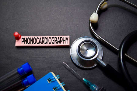 Phonocardiography text on Sticky Notes. Top view isolated on black background. HealthcareMedical concept