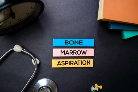 Bone Marrow Aspiration text on Sticky Notes. Top view isolated on black background. HealthcareMedical concept