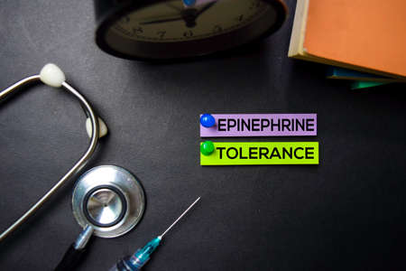 Epinephrine Tolerance text on Sticky Notes. Top view isolated on black background. HealthcareMedical concept