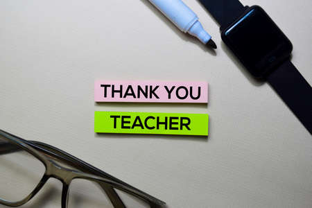 Thank You Teacher text on sticky notes isolated on office desk 版權商用圖片