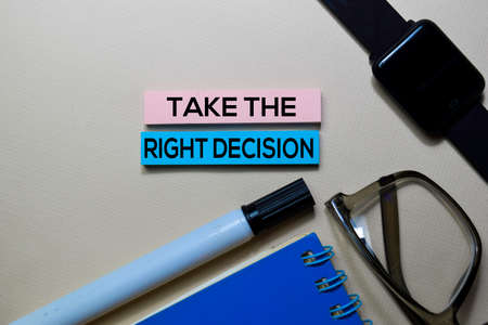 Take The Right Decision text on sticky notes isolated on office desk