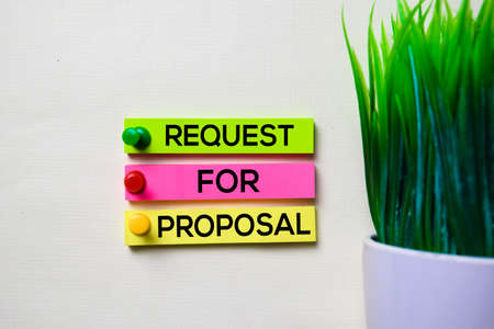 Request For Proposal text on sticky notes isolated on office desk