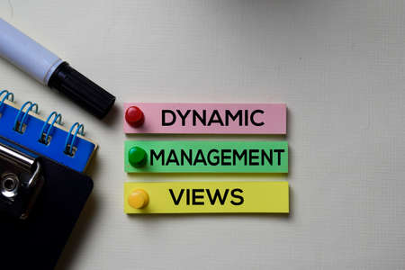 Dynamic Management Views - DMV text on sticky notes isolated on office desk