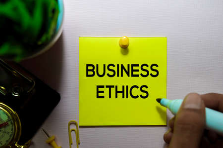 Business Ethics text on sticky notes isolated on office desk