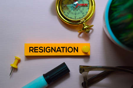 Resignation text on sticky notes isolated on office desk Foto de archivo