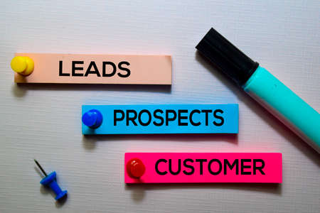 Leads, Prospects, Customer text on sticky notes isolated on office desk Archivio Fotografico