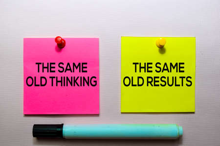 The Same Old Thinking and The Same Old Results text on sticky notes isolated on office desk Stock Photo