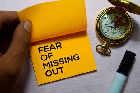 Fear Of Missing Out (FOMO) text on sticky notes isolated on office desk