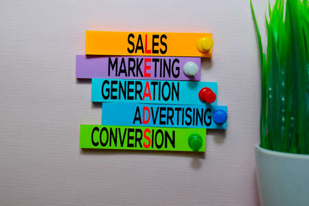 Sales, Marketing, Generation, Advertising, Conversio (LEADS) text on sticky notes isolated on office desk Stock Photo