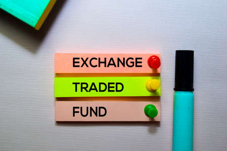 Exchange Traded Fund (ETF) text on sticky notes isolated on office desk Stock Photo
