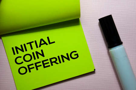 Initial Coin Offering (ICO) text on sticky notes isolated on office desk Stock Photo