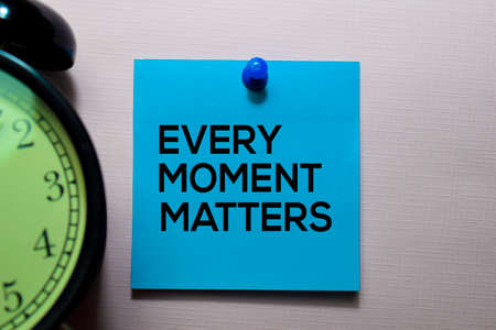 Every Moment Matters text on sticky notes isolated on office desk