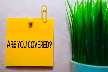 Are You Covered? text on sticky notes isolated on office desk