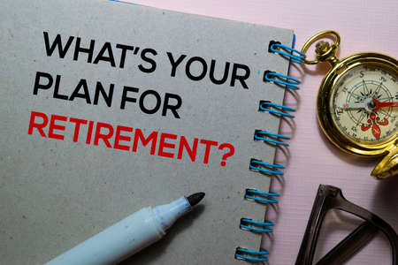 Whats Your Plan For Retirement? text on the book isolated on office desk Stock Photo