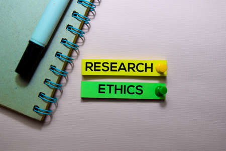 Research Ethics text on sticky notes isolated on office desk Stock Photo