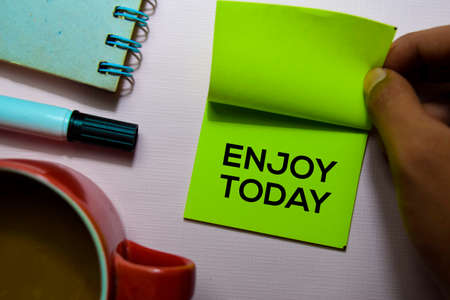 Enjoy Today text on sticky notes isolated on office desk