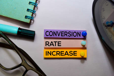 Conversion Rate Increase (CRI) text on sticky notes isolated on office desk