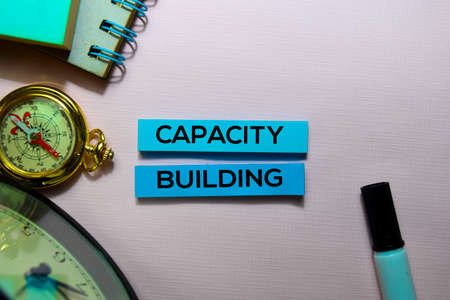 Capacity Building text on sticky notes isolated on office desk