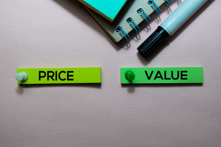 Price Vs Value text on sticky notes isolated on office desk Stock Photo