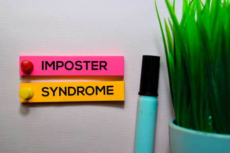 Imposter Syndrome text on sticky notes isolated on office desk Stock Photo