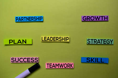 Leadership, Plan, Partnership, Growth, Strategy, Skill, Teamwork, Success text on sticky notes isolated on green desk. Mechanism Strategy Concept