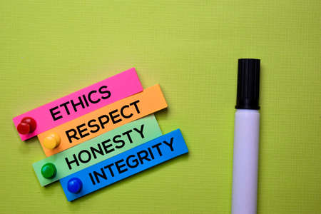 Ethics, Respect, Honesty, Integrity text on sticky notes isolated on green desk. Mechanism Strategy Concept