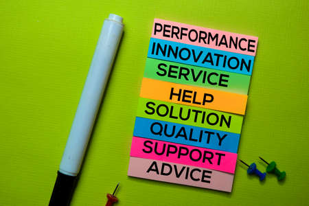 Performance, Innovation, Service, Help, Solution, Quality, Support, Advice text on sticky notes isolated on green desk. Mechanism Strategy Concept