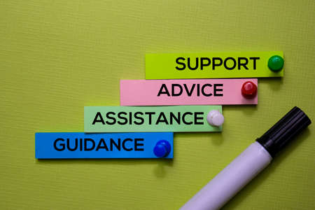 Support, Advice, Assistance, Guidance text on sticky notes isolated on green desk. Mechanism Strategy Concept Stock Photo
