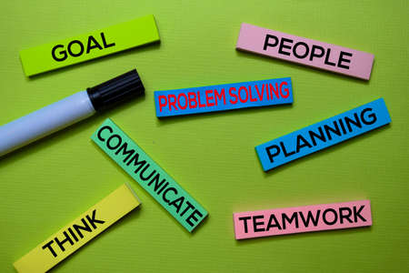 Problem Solving, Goal, People, Communicate, Planning, Think, Teamwork text on sticky notes isolated on green desk. Mechanism Strategy Concept Stock Photo