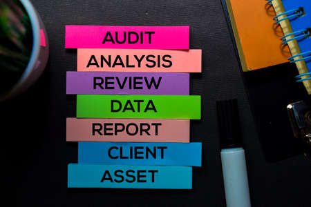 Audit, Analysis, Review, Data, Report, Client, Asset text on sticky notes isolated on Black desk. Mechanism Strategy Concept Stock Photo
