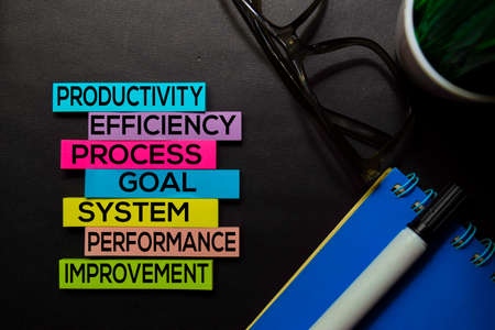 Productivity, Efficiency, Process, Goal, System, Performance, Improvement text on sticky notes isolated on Black desk. Mechanism Strategy Concept Stock Photo