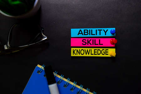 Ability, Skill, Knowledge text on sticky notes isolated on Black desk. Mechanism Strategy Concept Stock Photo
