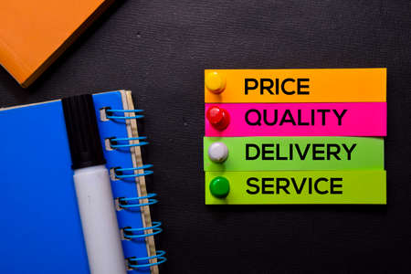 Price, Quality, Delivery, Service text on sticky notes isolated on Black desk. Mechanism Strategy Concept