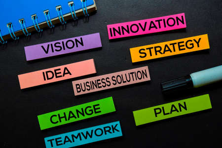 Vision, Innovation, Idea, Business Solution, Strategy, Change, Teamwork, Plan text on sticky notes isolated on Black desk. Mechanism Strategy Concept