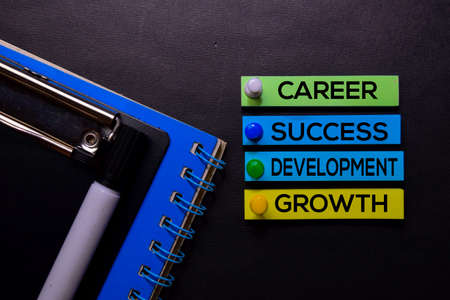 Career, Success, Development, Growth text on sticky notes isolated on Black desk. Mechanism Strategy Concept