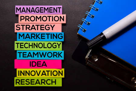Management, Promotion, Strategy, Marketing, Technology, Teamwork, Idea, Innovation, Research text on sticky notes isolated on Black desk. Mechanism Strategy Concept