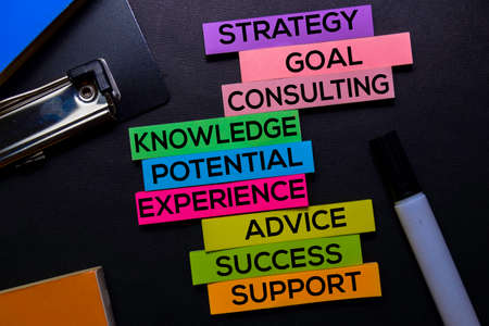 Strategy, Goal, Consulting, Knowledge, Potential, Experience, Advice, Success, Support text on sticky notes isolated on Black desk. Mechanism Strategy Concept