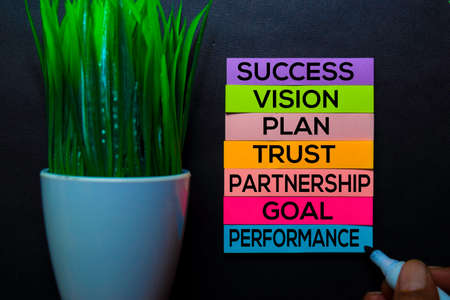 Success, Vision, Plan, Trust, Partnership, Goal, Performance text on sticky notes isolated on Black desk. Mechanism Strategy Concept Stock Photo