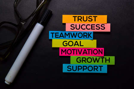 Trust, Success, Teamwork, Goal, Motivation, Growth, Support text on sticky notes isolated on Black desk. Mechanism Strategy Concept